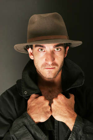 Attractive man in hat and trench coat Stock Photo - 3174914