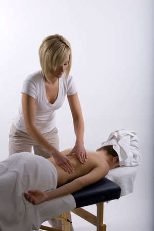 deeptissue: Young girl getting massage from a therapist
