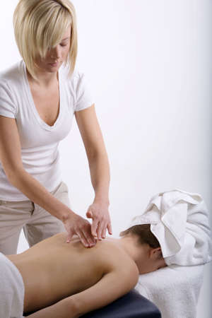 Young girl getting massage from a therapist Stock Photo - 3175105