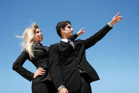 Young successful businessman and businesswoman  photo