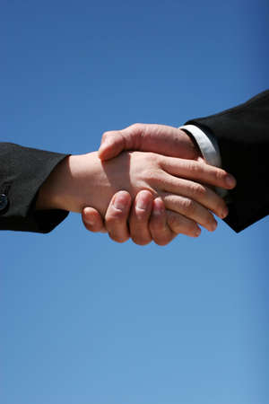 Young girl and guy handshaking for business Stock Photo - 3361613