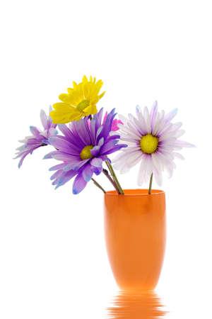 Colorful daisy arrangement in orange vase photo