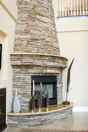 modern: Modern stone fireplace in the living room