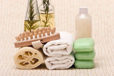 Spa towels, soaps, loofah, r and essential oils photo