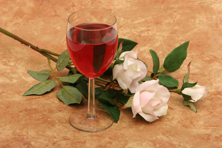 white wine: Glass of red wine and white roses Stock Photo