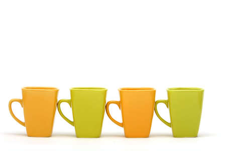 Colorful coffee cups on isolated white background