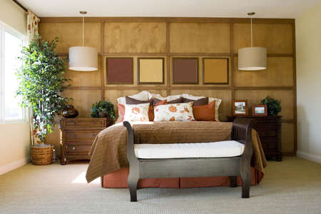 Modern tastefully decorated master bedroom photo
