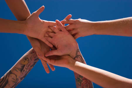 Group of people hands in the air Stock Photo - 3361610
