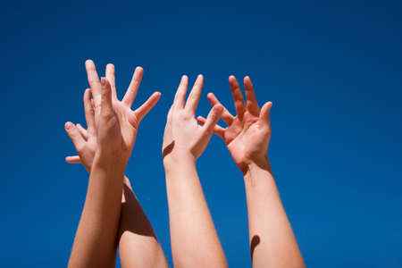 reaching: Group of people hands in the air Stock Photo