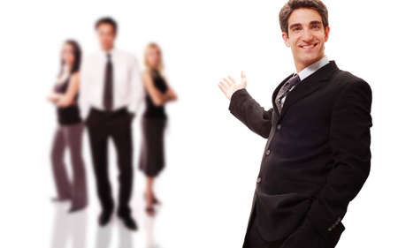 Businessman standing front of his team with confidence Stock Photo - 3377787