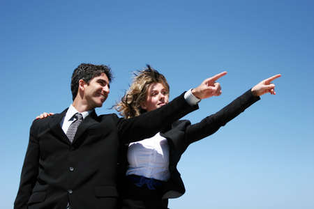 Young successful businessman and businesswoman Stock Photo - 3377393