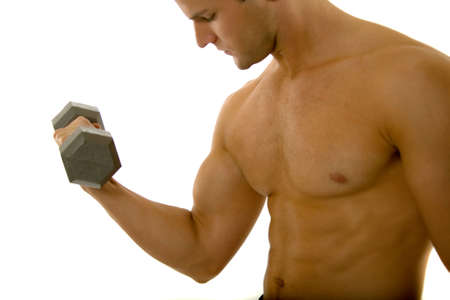 Young male excersizing with dumbbells photo