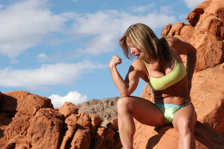 Beautiful mature woman exercising outdoors Standard-Bild