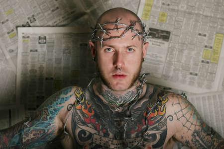 Man in tattoos photo