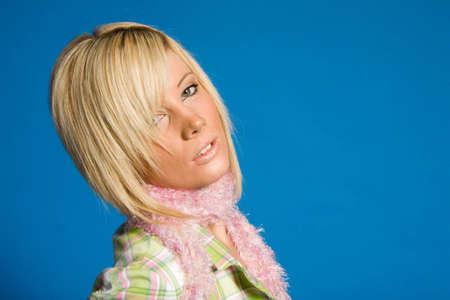 Beautiful blonde girl posing in casual fashionable clothing photo