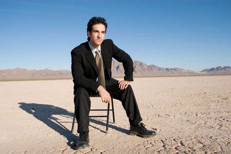 Businessman sitting on a chair Stock Photo - 3391318