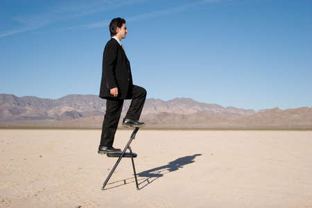 Businessman climbing up the corporate ladder Stock Photo - 3391603