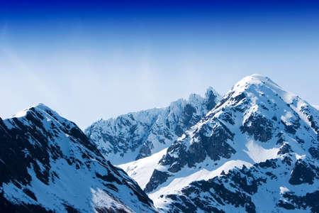 Snow melting on the mountains photo