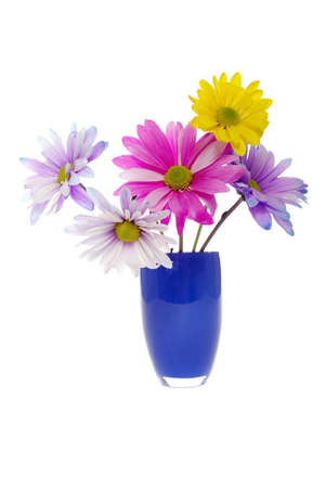 Colorful daisy arrangement in blue vase photo