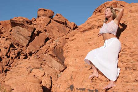 Beautiful mature woman dancing outdoors Standard-Bild