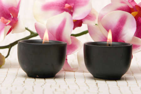 Aromatherapy candles and pink orchid Stock Photo - 3391634