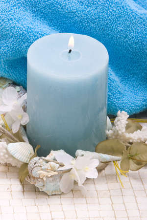 rejuvenating:  stones, candle and daisies