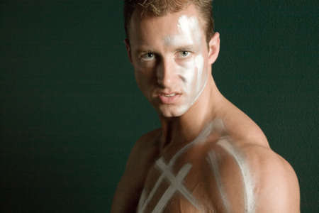 body paint: Handsome man in face and body paint