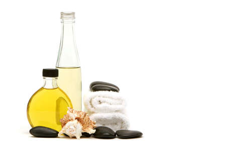 spa towels: Spa towels, rocks and oils on isolated white background