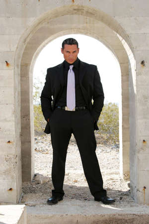 Attractive businessman in dark suit photo