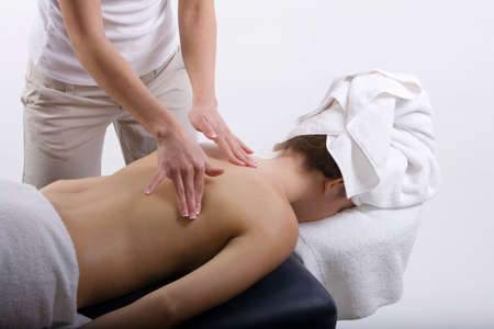 Young girl getting massage from a therapist Stock Photo - 3391313
