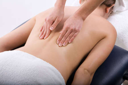 deeptissue: Massage therapist giving a massage