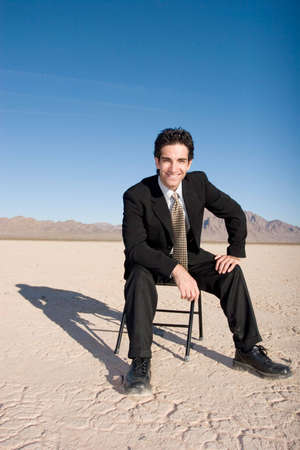 Businessman sitting on a chair Stock Photo - 3401386