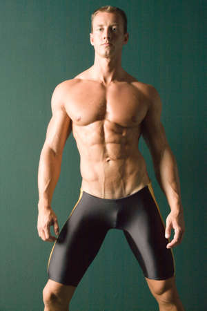 Champion body builder posing