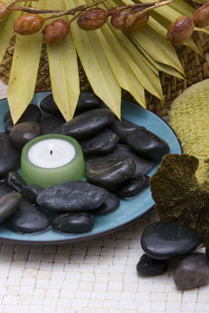rejuvenating: Spa stones and candle in a bowl Stock Photo