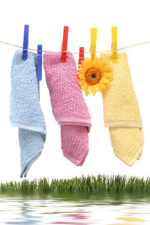 Towels hanging on the rope by clothespin photo
