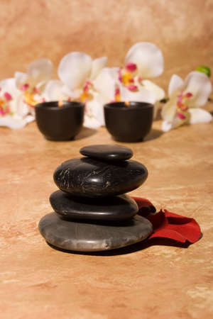 insent:  stones and orchid flowers with candles Stock Photo