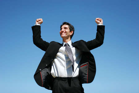 Successful businessman jumping to celebrate Stock Photo - 3401062
