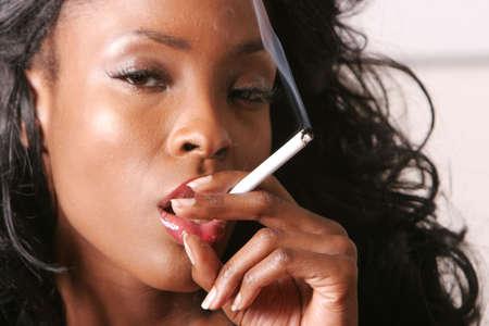 Black woman smoking photo