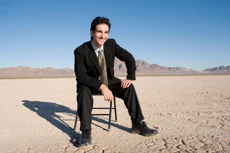 Businessman sitting on a chair Stock Photo - 3407091