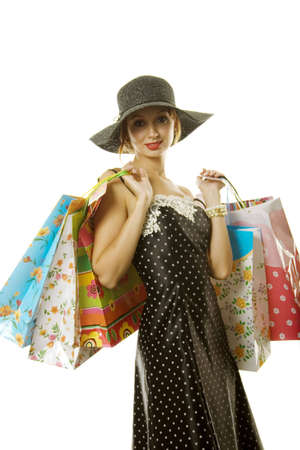 gift spending: Pretty woman with shopping bags