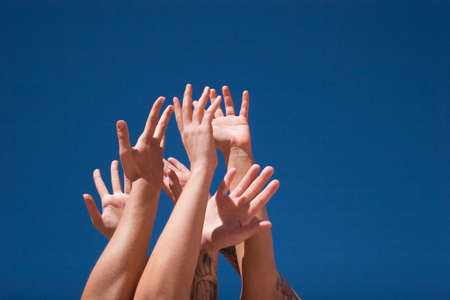 multiple: Group of people hands in the air Stock Photo