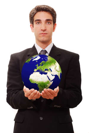 Successful businessman holding globe against isolated background photo
