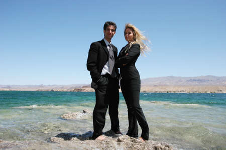Young successful businesswoman and businessman photo