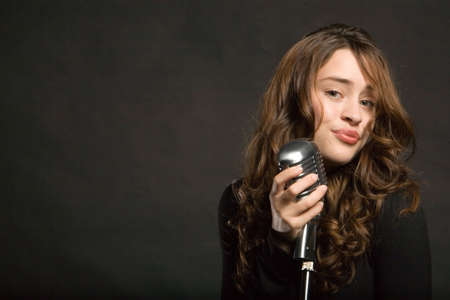 recording studio: Beautiful sexy young woman singing