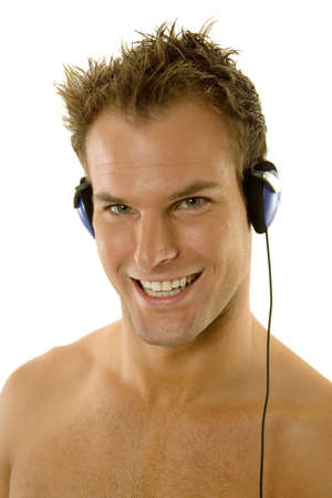 Young male listening music with headphones Фото со стока