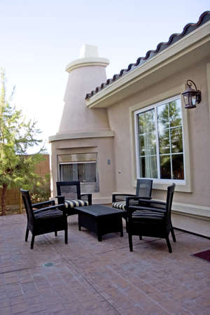 Outdoor fireplace and sitting area 스톡 콘텐츠