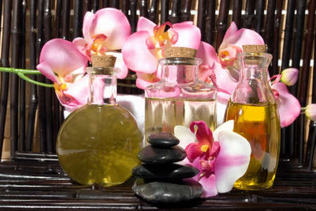 Essential body  oils in bottles for bodycare photo