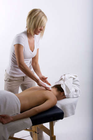 Young girl getting massage from a therapist Stock Photo - 3451366