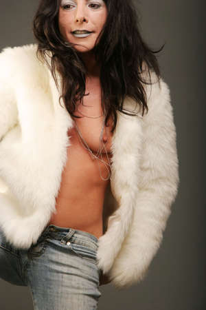 Sexy topless woman in fur jacket Stock Photo