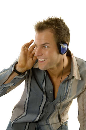 Young male in casual outfit listening music photo